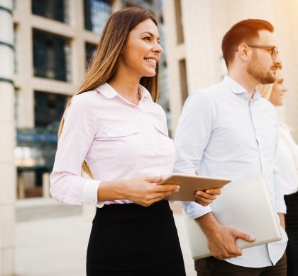 Picture of young attractive business partners standing outdoor